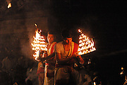 Brilliant spectacles of light from handheld towers of candles, held by priests and other Hindis during religious rites (pujas). Colorful and popular Dasasvamedha Ghat gets a lot of attention from religious pilgrims, locals, and tourists alike and is one of the busiest bathing ghats in the city of Varanasi.