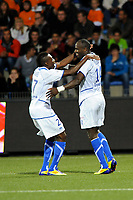 FOOTBALL - FRENCH CHAMPIONSHIP 2011/2012 - L1 - FC LORIENT v AJ AUXERRE - 21/09/2011 - PHOTO PASCAL ALLEE / DPPI - JOY DENNIS OLIECH (R) (FCL) AFTER HIS GOAL. HE IS CONGRATULATED BY ALAIN TRAORE