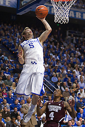 UK guard Jarrod Polson puts back a missed shot in the first half. The University of Kentucky Men's Basketball team hosted Mississippi State , Wednesday, Feb. 27, 2013 at Rupp Arena in Lexington .