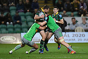 Northampton Saints centre Fraser Dingwall (22) takes a tackle during the Gallagher Premiership Rugby match between Northampton Saints and Harlequins at Franklins Gardens, Northampton, United Kingdom on 1 November 2019.