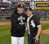 CHICAGO - APRIL 25:  Actor Jeremy Piven poses with White Sox pitcher Mark Buehrle after throwing out a ceremonial first pitch on April 25, 2010 at U.S. Cellular Field in Chicago, Illinois.  (Photo by Ron Vesely)
