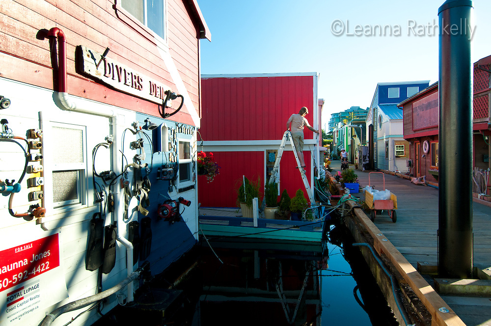 Fisherman's Wharf in Victoria, BC, is home to dozens of colorful houseboats and is a favorite tourist spot. Residents maintain their float homes regularly.