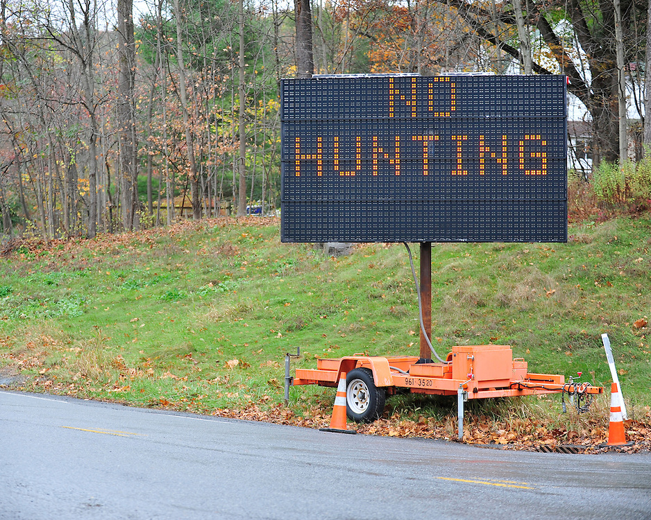 A sign posted on Route 447 indicates no hunting is permitted in the area. Police and federal agents continue to comb the Pocono Mountains in search of alleged cop killer Eric Matthew Frein Oct. 22, 2014, near Henryville, Pa. (Chris Post | lehighvalleylive.com)