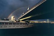 "Deutzer Brücke (Deutz Bridge), double rainbow over the ""River Cloud"" anchoring on the Rhine."