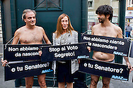 Roma 15 Ottobre 2013<br /> Gli attivisti di Avaaz manifestano nudi di fronte al Senato per l'abolizione del voto segreto su questioni cruciali come la decadenza da senatore di Silvio Berlusconi. Paola Taverna, capogruppo al Senato del Movimento 5 Stelle, con gli attivisti di Avaaz nudi<br /> Rome October 15, 2013<br /> Avaaz activists demonstrate naked in front of the Senate for the abolition of secret voting on crucial issues such as the decline from Senator of  Silvio Berlusconi.   Paola Taverna, leader of the Senate of the Movement 5 Stars, with activists from Avaaz naked