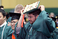 Senior Adrian Kemal Bayraktaroglu of Fairborn tries on his LED studded cap backstage before Wright State University's 43rd Semiannual Commencement at the Nutter Center, Saturday, June 12, 2010.  Asked why he made it, he replied he was an engineering student, and 'it's what we do.'