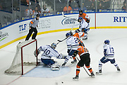 A crossing attempt skips across the crease during the Atlantic Hockey semifinal between RIT and Air Force at the Blue Cross Arena at the War Memorial in Rochester on Friday, March 18, 2016.