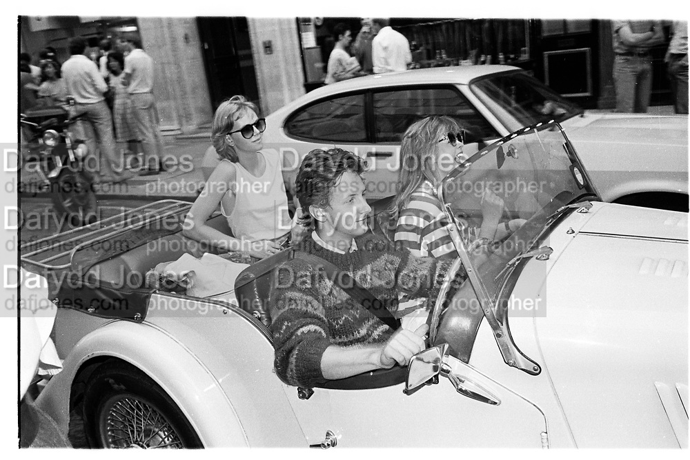 John Benson and Lady Helen Windsor in the front of his Morgan, Cork St.  Party. London. 26 July 1983.. SUPPLIED FOR ONE-TIME USE ONLY> DO NOT ARCHIVE. © Copyright Photograph by Dafydd Jones 248 Clapham Rd.  London SW90PZ Tel 020 7820 0771 www.dafjones.com