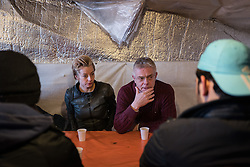 © London News Pictures. Calais, France. 04/03/16. Film Producer Tracey Seaward (left) and Director Stephen Daldrey meet with four unaccompanied Syrian boys who live in the Calais 'Jungle' camp and have family in Britain. They are the first celebrities to join the Citizens UK and Help Refugees 'buddy scheme' which aims to put pressure on the British government to allow unaccompanied minors in the Calais 'Jungle' to be reunited with their families in the United Kingdom.   Photo credit: Rob Pinney/LNP