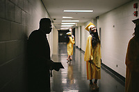 Travis Widdington waits backstage before graduating with his 65 classmates from Orr High School, a Chicago Public School that has suffered from low enrollment and underfunding. |||| Rites of Passage define our lives. They signify the progress of time as well as our citizenship in a tribe, in a culture — in life itself. Chicago commemorates these moments in ways that reflect its diversity, but through difference, we find commonality. We are all connected through these formal and informal ceremonies that remind us how much family, love and time shape us.