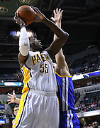 Feb. 28, 2012; Indianapolis, IN, USA; Indiana Pacers center Roy Hibbert (55) shoots the ball against Golden State Warriors center Andris Biedrins (15) at Bankers Life Fieldhouse. Mandatory credit: Michael Hickey-US PRESSWIRE