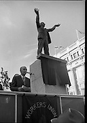 Jim Larkin Statue. O'Connell Street Dublin.   (M77)..1979..15.06.1979..06.15.1979..15th June 1979..Today saw the unveiling of a statue in memory of James (Big Jim) Larkin. Larkin was a trade union activist who was a thorn in the side of many employers who refused to allow workers join unions. A dispute with The Dublin United Tramway Company  escalated into what is now known as the great lock out. Employers banded together and wanted workers to sign a pledge stating that they would not join Larkin's union the Irish Transport And General workers Union (ITGWU). The lock out lasted seven months. During this time Larkin was nited for his rhetoric in standing up for the poor and oppressed within Irish Society...Jim Larkin: Born Jan 21 1876 .Died Jan 30 1947...Image of President, Dr Patrick Hillery delivering the oration at the unveiling ceremony in O'Connell Street,Dublin.