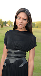 NAOMIE HARRIS at the Fashion Rules Exhibition Opening at Kensington Palace, London W8 on 4th July 2013.