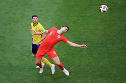 Sweden's Marcus Berg (left) and England's Harry Maguire battle for the ball during the FIFA World Cup, Quarter Final match at the Samara Stadium. PRESS ASSOCIATION Photo. Picture date: Saturday July 7, 2018. See PA story WORLDCUP Sweden. Photo credit should read: Adam Davy/PA Wire. RESTRICTIONS: Editorial use only. No commercial use. No use with any unofficial 3rd party logos. No manipulation of images. No video emulation.