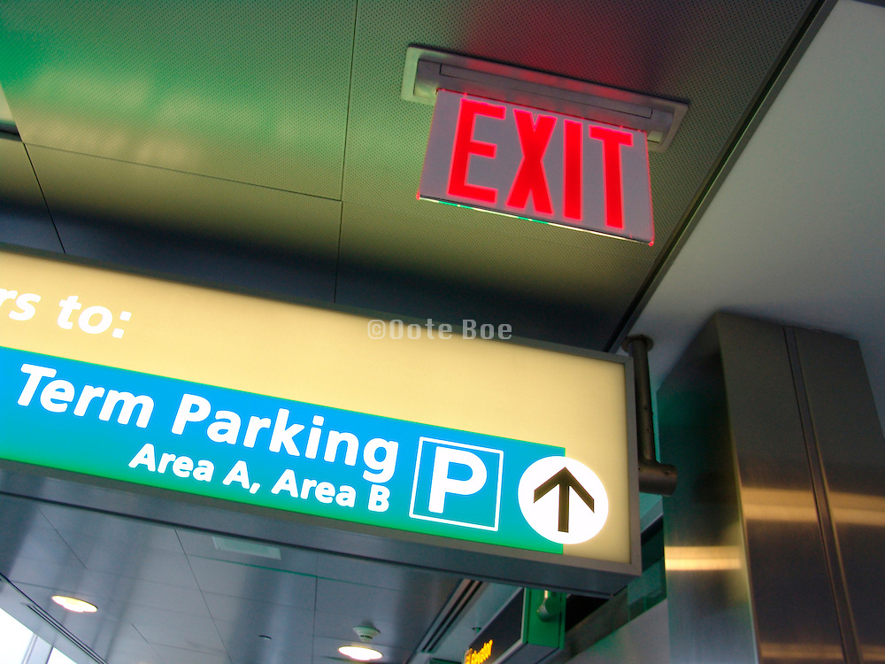 Exit sign to long term parking lot.
