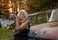 Carla Combs, lifelong snake lover and enthusiast, with one of her 16 pet snakes, Rome, New York