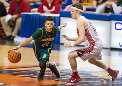 Huntington guard Tavian Dunn-Martin (11) tries to get past Hurricane guard Dylan Tinsley (13) during a semi-final game at the Charleston Civic Center.