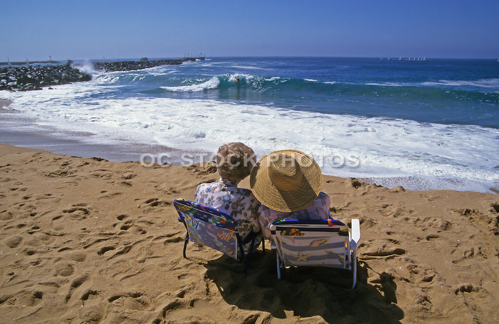 Elderly Couple Sitting on the Sand at the Newport Wedge