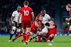 Fiji Lock Leone Nakarawa is tackled by England Flanker Chris Robshaw (capt) and Prop Dan Cole - Mandatory byline: Rogan Thomson/JMP - 07966 386802 - 18/09/2015 - RUGBY UNION - Twickenham Stadium - London, England - England v Fiji - Rugby World Cup 2015 Pool A.