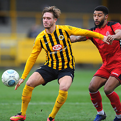 TELFORD COPYRIGHT MIKE SHERIDAN 2/3/2019 - Ellis Deeney of AFC Telford battles for the ball with Brad Abbott of Boston  during the National League North fixture between Boston United and AFC Telford United at the York Street Jakemans Stadium