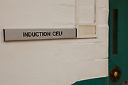 A sign for the induction cell on C wing, HMP Kingston. Portsmouth, United Kingdom. Kingston prison is a category C prison holding indeterminate sentenced prisoners.