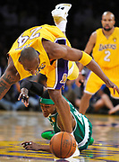 Kobe Bryant trips over the top of Rajon Rondo while going for a loose ball in the first half. The Lakers defeated the Boston Celtics in game 7 of the NBA Finals  83-79 in Los Angeles, CA 06/16/2010 (John McCoy/Staff Photographer)