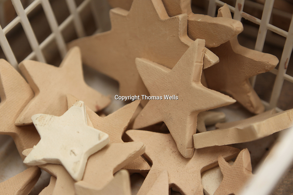A basket full of bisque stars just waiting for glaze to be applied.
