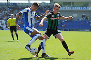 Matthew Briggs of Colchester United does battle with Andy Cannon of Rochdale during the Sky Bet League 1 match between Colchester United and Rochdale at the Weston Homes Community Stadium, Colchester<br /> Picture by Richard Blaxall/Focus Images Ltd +44 7853 364624<br /> 08/05/2016