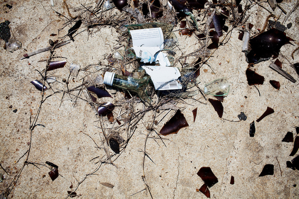 A broken bottle of Boone's Farm litters the ground of the Baptist Town neighborhood of Greenwood, Mississippi on  Wednesday, May 19, 2010.