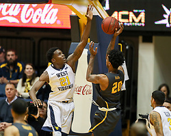Dec 20, 2017; Morgantown, WV, USA; West Virginia Mountaineers forward Wesley Harris (21) blocks a shot by Coppin State Eagles forward Jordan Hardwick (20) during the second half at WVU Coliseum. Mandatory Credit: Ben Queen-USA TODAY Sports