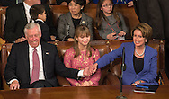 House Minority Leader Nancy Pelosi, (D-CA), right, reaches over to shake hands with House Minority Whip Rep. Steny Hoyer (D-MD), left, after he called out a vote in her favor for House Speaker during the opening session of the 113th US House of Representatives in the U.S. Capitol in Washington, D.C., January 3, 2013. UPI/Ken Cedeno..