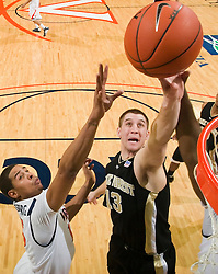 Wake Forest center Chas McFarland (13) shoots past Virginia guard Sylven Landesberg (15).  The Virginia Cavaliers fell to the #13 ranked Wake Forest Demon Deacons 70-60 at the John Paul Jones Arena on the Grounds of the University of Virginia in Charlottesville, VA on February 28, 2009.