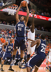 Xavier forward/center Jason Love (31) grabs a defensive rebound against UVA.  The #22 ranked Xavier Musketeers defeated the Virginia Cavaliers 84-70 at the John Paul Jones Arena on the Grounds of the University of Virginia in Charlottesville, VA on January 3, 2009.