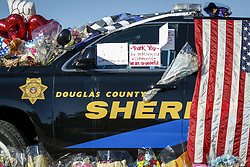 January 3, 2018  - Denver, Colorado, U.S. - Flowers and balloons on a police car are seen to mourn for Douglas County Sheriff's Deputy Zackari Parrish, who was shot and killed in the line of duty by a gunman on last Sunday morning, in Highlands Ranch, Colorado, the United States, on Jan. 2, 2018. Zackari Parrish was married and father of two children. (Credit Image: © Marc Piscotty/Xinhua via ZUMA Wire)