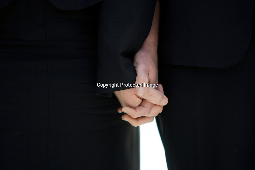 Plaintiffs Sandra B. Stier (L) and Kristin M. Perry hold hands outside the Supreme Court after their case against California's Proposition 8 gay marriage ban was argued in Washington.