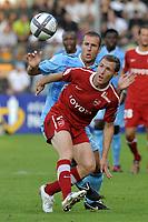 FOOTBALL - FRENCH CHAMPIONSHIP 2010/2011 - L1 - VALENCIENNES FC v OLYMPIQUE DE MARSEILLE - 14/08/2010 - PHOTO JEAN MARIE HERVIO / DPPI - DAVID DUCOURTIOUX (VA) / BENOIT CHEYROU (OM)