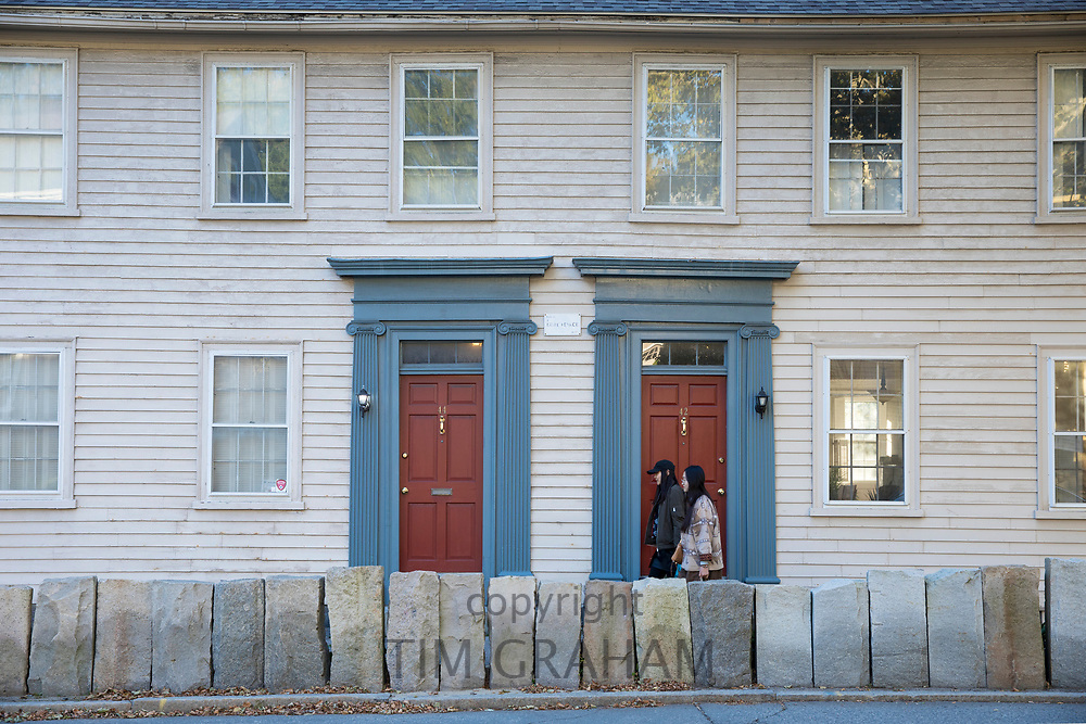 Locals walking past wooden clapboard elegant period houses on Benefit Street in Providence, Rhode Island, USA