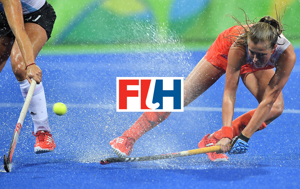 Netherland's Xan de Waard hits the ball during the women's quarterfinal field hockey Netherlands vs Argentina match of the Rio 2016 Olympics Games at the Olympic Hockey Centre in Rio de Janeiro on August 15, 2016.  / AFP / Carl DE SOUZA        (Photo credit should read CARL DE SOUZA/AFP/Getty Images)