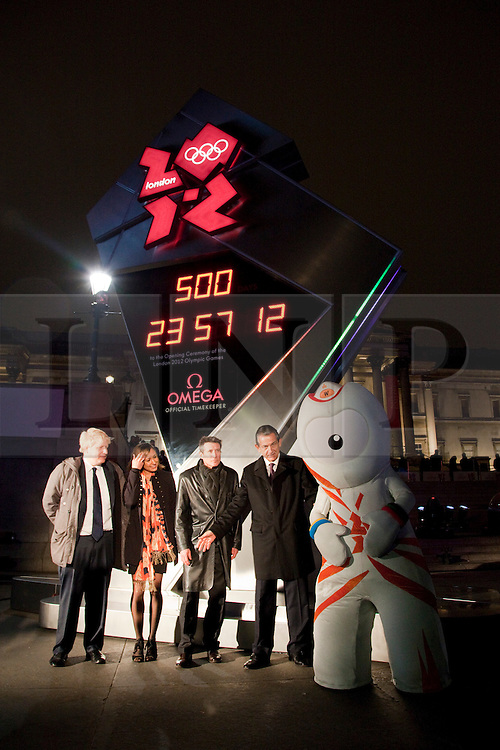 © under license to London News Pictures. 14/03/2011. Unveiling ceremony of Omega Olympic Games countdown clock. The clock is in London's Trafalgar Square and will remain until the opening of the 2012 games.(from left) London Mayor Boris Johnson, Heptathlete Jessica Ennis, chairman of the London Organising Committee for the Olympic Games Lord Sebastian Coe and Omega President Stephen Urquart and mascot Wenlock. Photo credit should read BETTINA STRENSKE/LNP