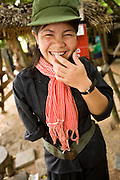 26 JUNE 2006 - SIEM REAP, CAMBODIA: CHUNG SOKNA, 16, wears an old Khmer Rouge type outfit as she greets visitors at the landmine museum operated by Aki Ra in Siem Reap. She lost her arm to a landmine in 1999 while she was looking after her family cows near Siem Reap. Aki Ra was a child soldier drafted by first the Khmer Rouge and later the Vietnamese army. One of his responsibilities was to plant land mines for both sides. After peace came to Cambodia he started his own demining operation. He has been clearing landmines in Cambodia since 1990. Cambodians are still wrestling with the legacy of the war in Vietnam and subsequent civil wars. At one time it was the most heavily mined country in the world and a vast swath of Cambodia, along the Thai-Cambodian border, is still mined. In 2004, more than 800 people were killed by mines and unexploded ordinance still found in the countryside. In addition to demining operations Aki Ra has an orphanage for 20 children maimed by mines.  Photo by Jack Kurtz