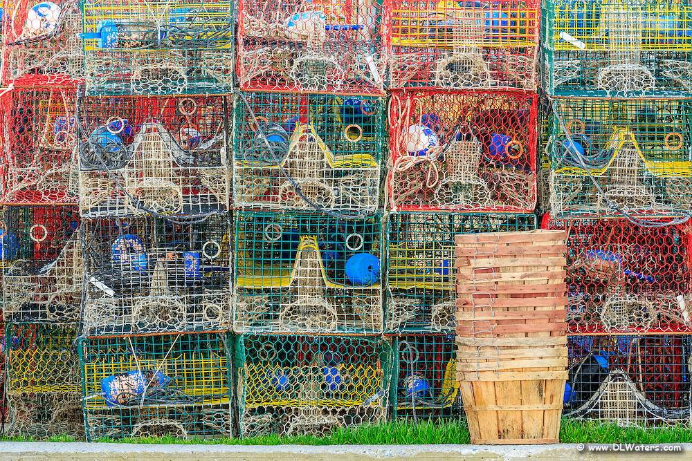 Pattern of colorful crab traps and baskets waiting for crabbing season in Wancheese NC.