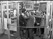 Opening of New Ogra Fianna Fail office on O'Connell St,Dublin.1982.30.01.1982.01.30.1982.30th January 1982..Image of Mr Charles Haughey,.Leader of Fianna Fail,.jokingly trimming the beard of an activist before the official cutting of the ribbon.