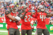 Tampa Bay Buccaneers Linebacker Kevin Minter (51) , Tampa Bay Buccaneers Running BackT. J. Logan (22) and Tampa Bay Buccaneers Running BackDare Ogunbowale (44) celebrate an interception during the International Series match between Tampa Bay Buccaneers and Carolina Panthers at Tottenham Hotspur Stadium, London, United Kingdom on 13 October 2019.