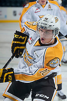 KELOWNA, CANADA - OCTOBER 25: Kale Clague #10 of Brandon Wheat Kings takes a shot during warm up against the Kelowna Rockets on October 25, 2014 at Prospera Place in Kelowna, British Columbia, Canada.  (Photo by Marissa Baecker/Shoot the Breeze)  *** Local Caption *** Kale Clague;