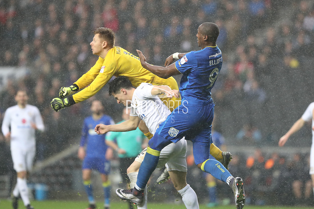 Milton Keynes Dons goalkeeper David Martin (1) punches clear from AFC Wimbledon striker Tom Elliott (9) during the EFL Sky Bet League 1 match between Milton Keynes Dons and AFC Wimbledon at Stadium MK, Milton Keynes, England on 10 December 2016. Photo by Stuart Butcher.