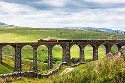 © Licensed to London News Pictures. 12/06/2018. Stonehouse UK. A DB Cargo freight train pulls it's load over the Arten Gill viaduct in the Yorkshire Dales today. Arten Gill viaduct was built as part of the Settle & Carlisle Railway between 1870-1875 by Victorian engineer John Sydney Crossley & constructed using Dent Marble, it has eleven arches & spans 201 metres. Photo credit: Andrew McCaren/LNP