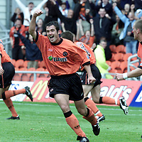 Dundee Utd v St Johnstone<br />David Hannah celebrates after his shot was deflected in by Hasney Aljofree pictured in the back right<br /><br />Pic by Graeme Hart<br />Copyright Perthshire Picture Agency<br />Tel: 01738 623350 / 07990 594431