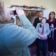 11/11/11 Elkton MD: Laura Shipkowski (Left) photographs her nephew William M. Stevens, Mary Rash (Grandmother) and Susan Stevens of New Castle Delaware before their wedding ceremony Friday, Nov. 11, 2011 at Elkton Wedding Chapel in Elkton Maryland...Special to The News Journal/SAQUAN STIMPSON