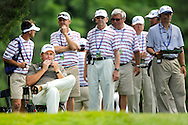 Phil Mickelson grabs a snack as he waits to tee off during the U.S. Open at Congressional Country Club.
