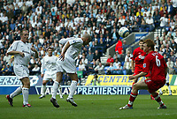 Photo. Andrew Unwin.<br /> Bolton Wanderers v Liverpool, Barclays Premiership, Reebok Stadium, Bolton 29/08/2004.<br /> Liverpool's John Arne Riise (R) can only watch as Bolton's Stelios (C) directs his header towards the goal<br /> NORWAY ONLY